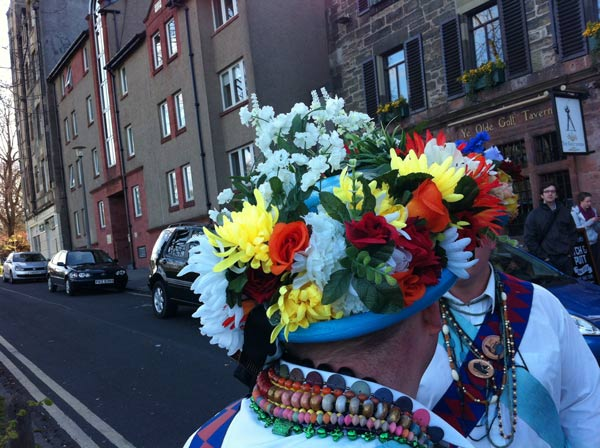 Morris man's hat bedecked with flowers