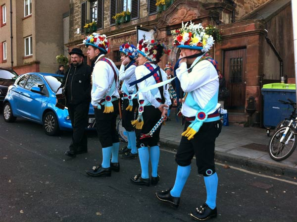Morris men relaxing between dances