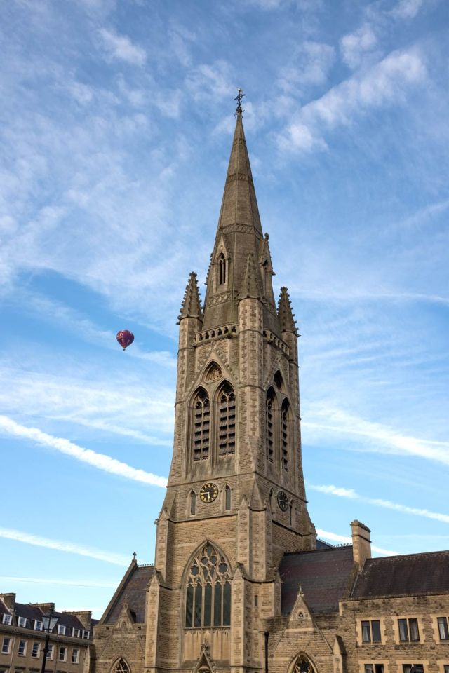 hot air balloon over a church in Bath, Somerset