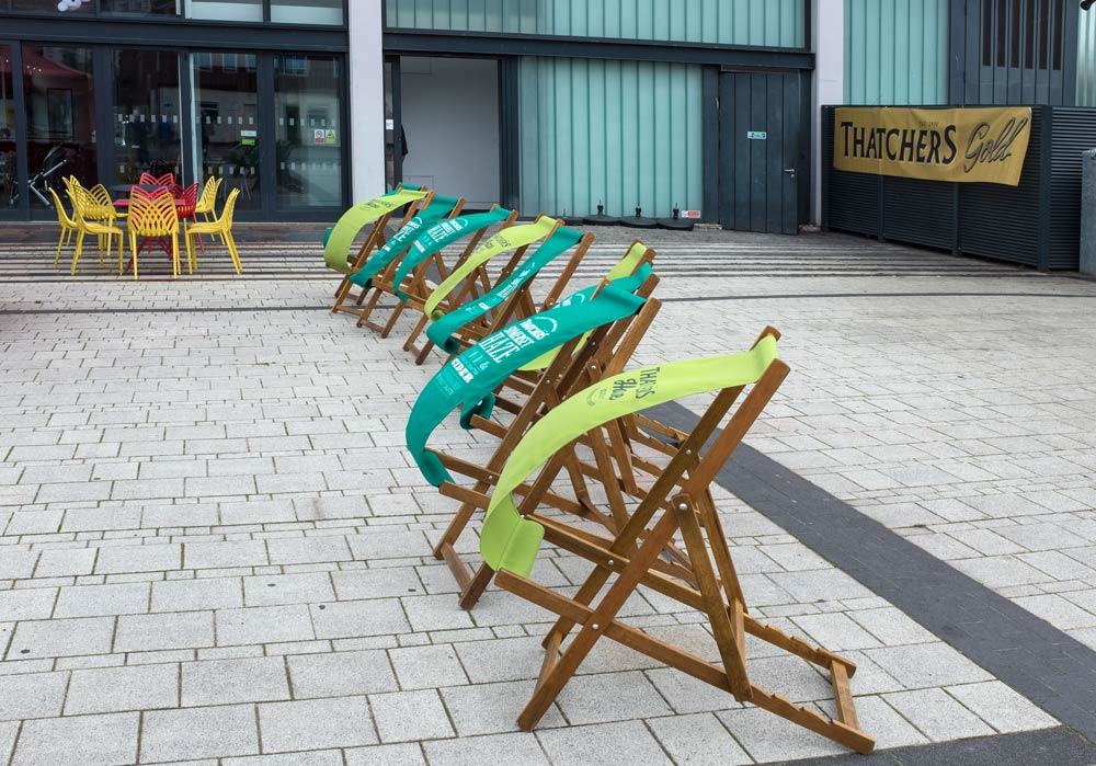 A row of deckchairs blowing in the wind
