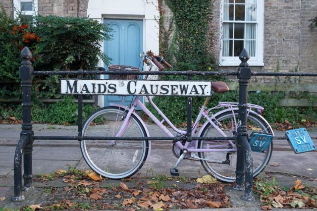 street sign for maid's causeway in  Cambridge with bicycle