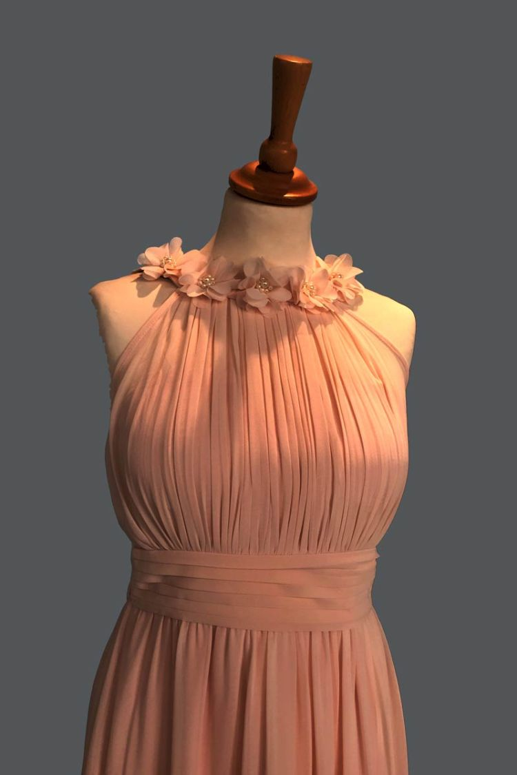 salmon-pink dress on a mannequin