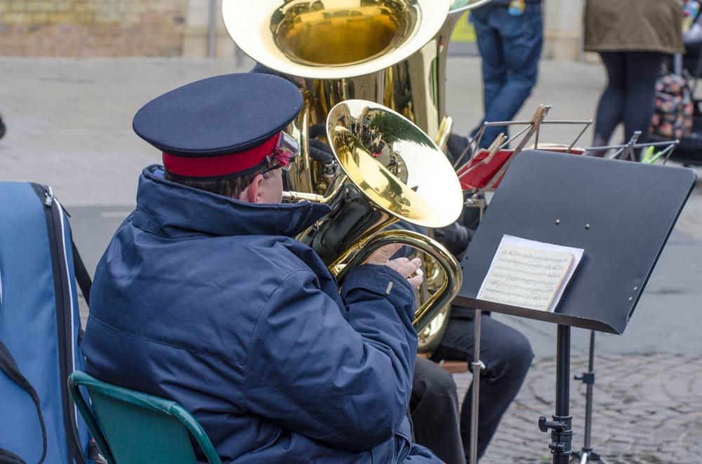 Salvation Army band member in uniform playing in Cambridge