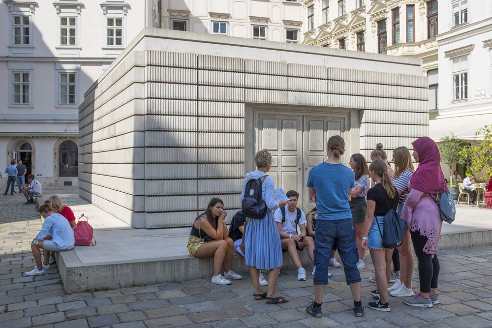group of young people at the memorial to the holocaust in the judenplatz in Vienna
