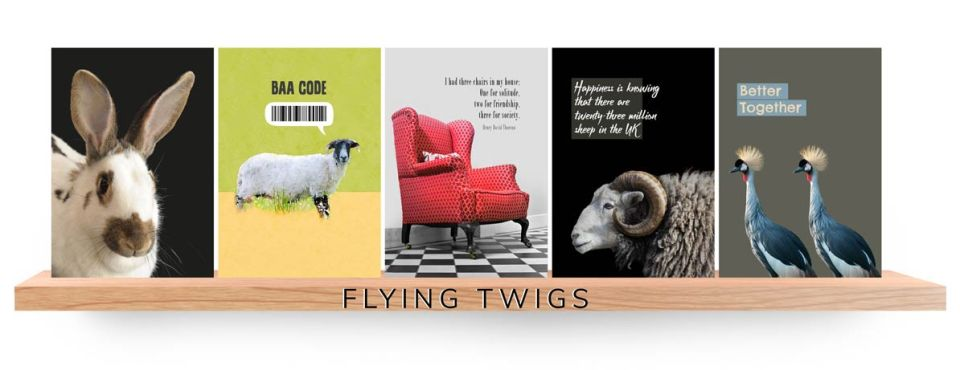 four greeting cards on a wooden shelf