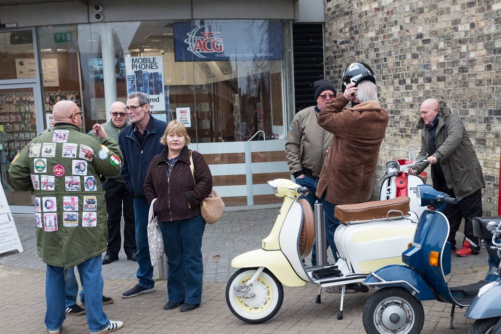 vespa scooters - and riders talking