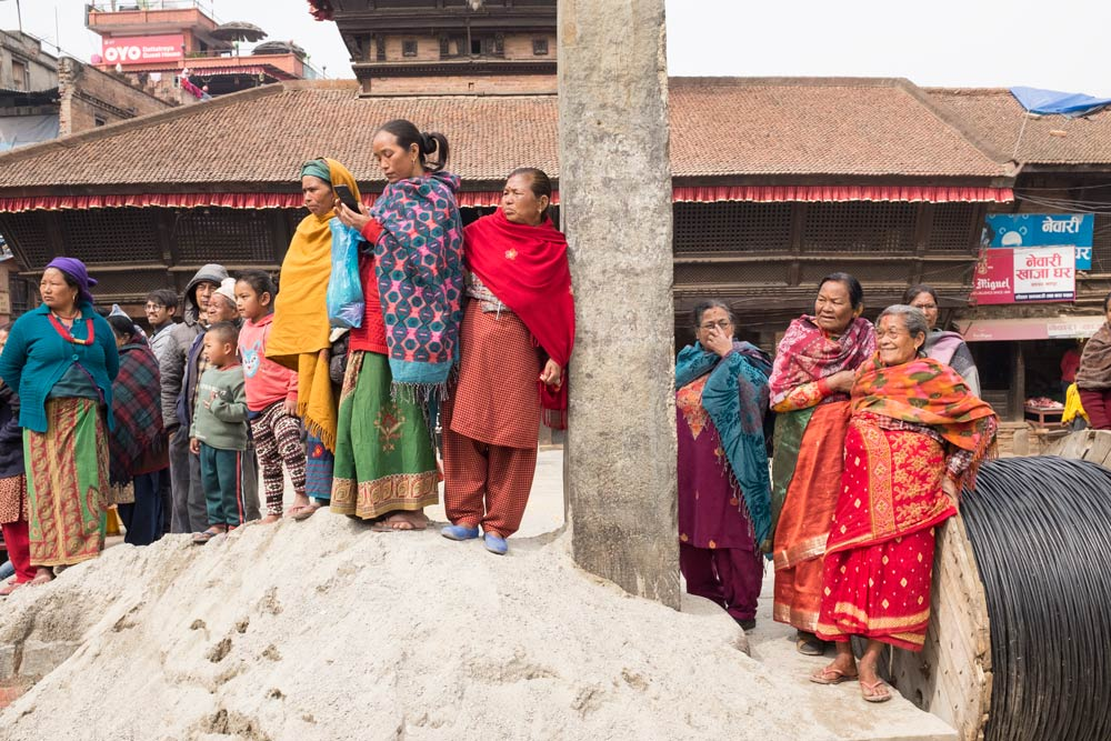 people in Bhaktapur in Nepal waiting for a performance to begin