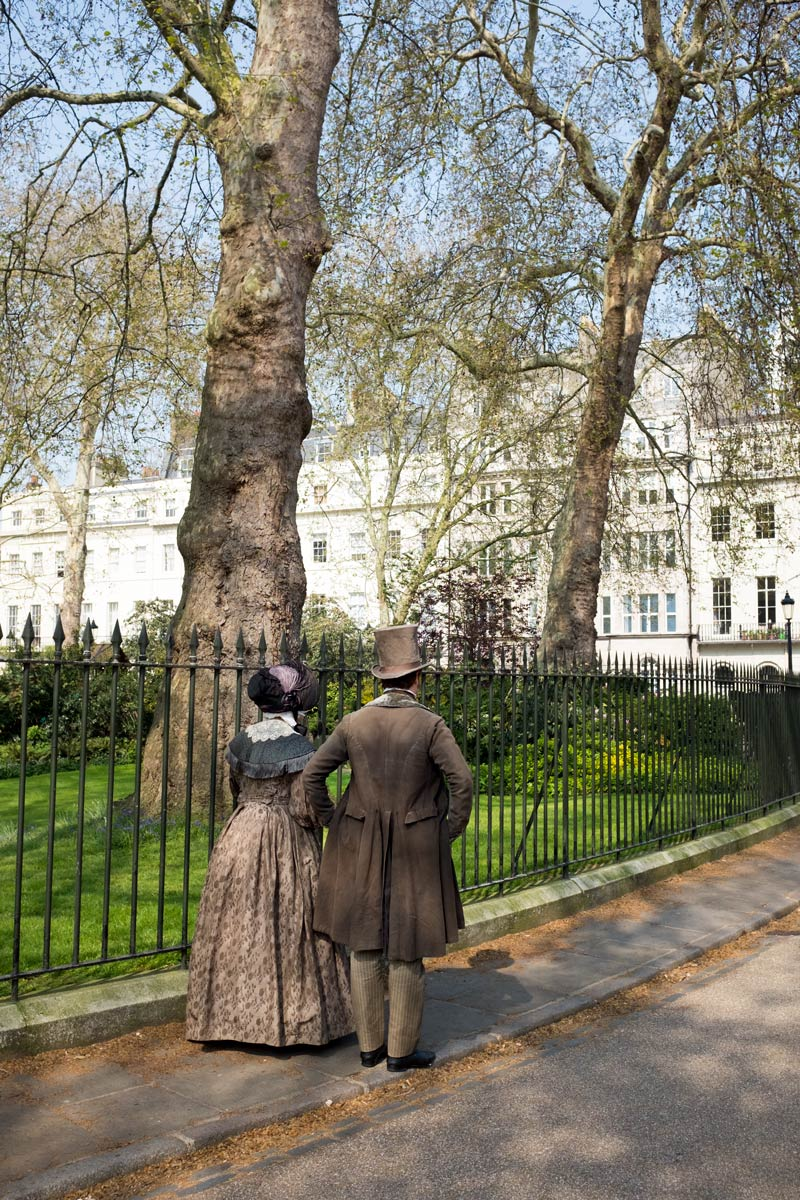 Couple in period costume in Fitzroy Square for the filming of Ammonite, about the life and love of Mary Anning