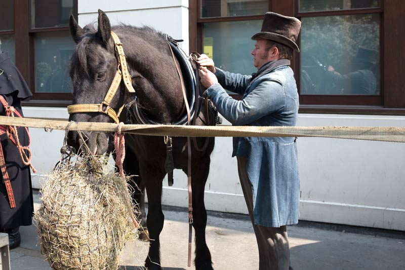 Horse with person in period costume near Fitzroy Square for the filming of Ammonite, about the life and love of Mary Anning