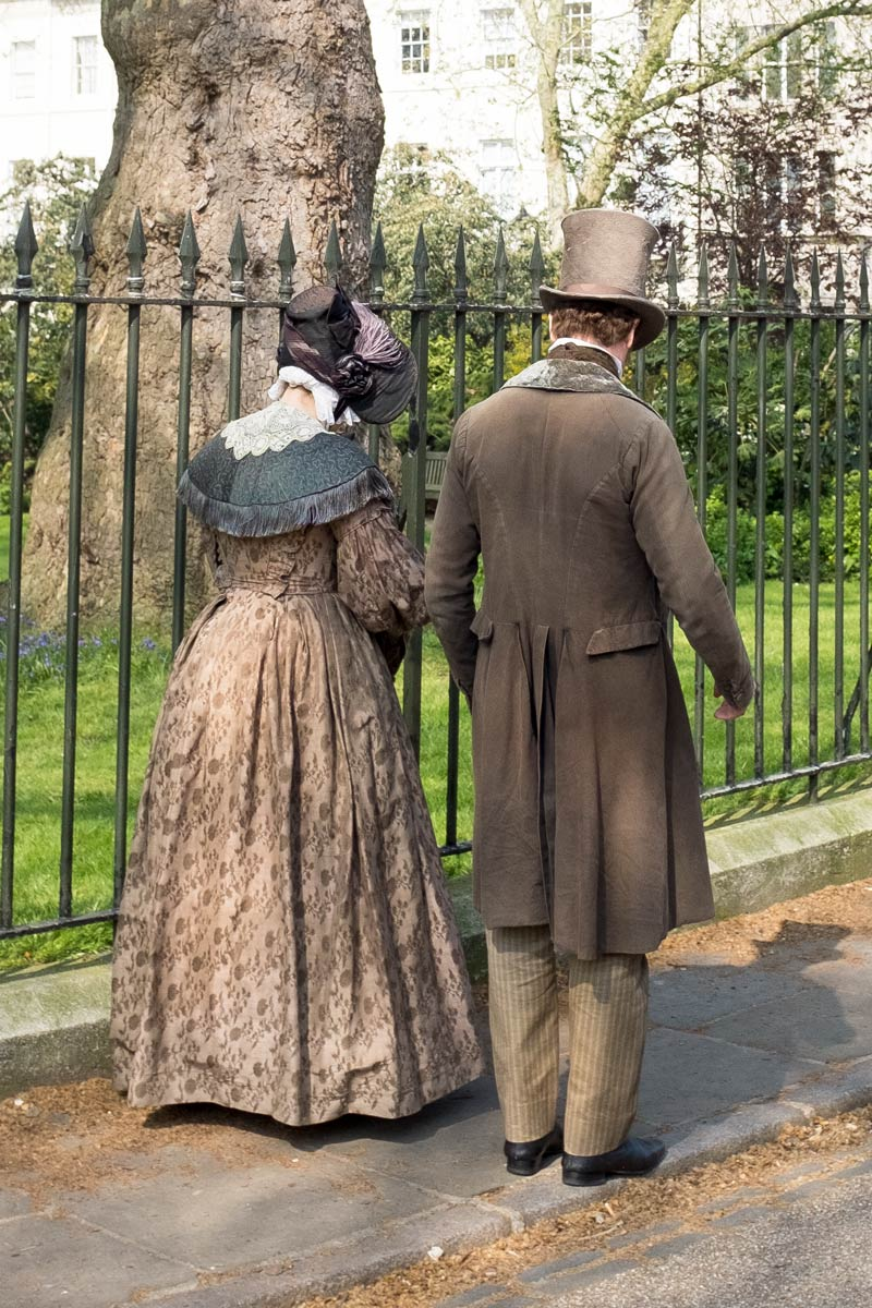 Couple in period costume in Fitzroy Square, London