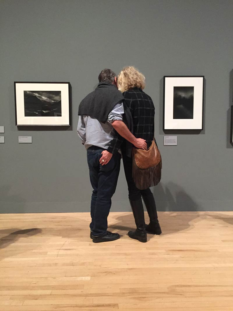 Couple look at Don McCullin photo at the Tate Modern exhibition.