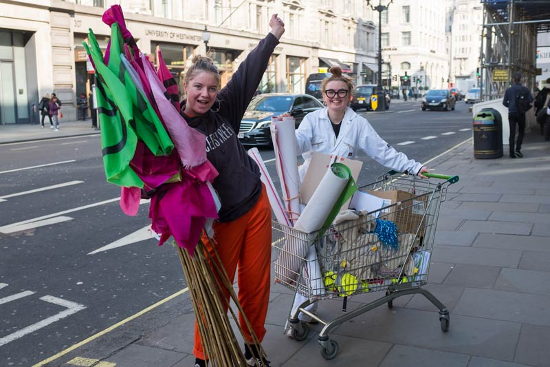 Two women on their way to the Extinction Rebellion protest in London