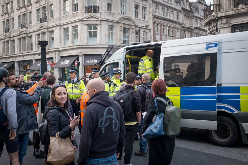 Matter of fact, polite arrests at the Extinction Rebellion protest at Oxford Circus, London