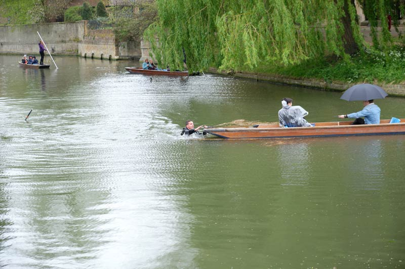 man overboard punting on the River Cam at Cambridge