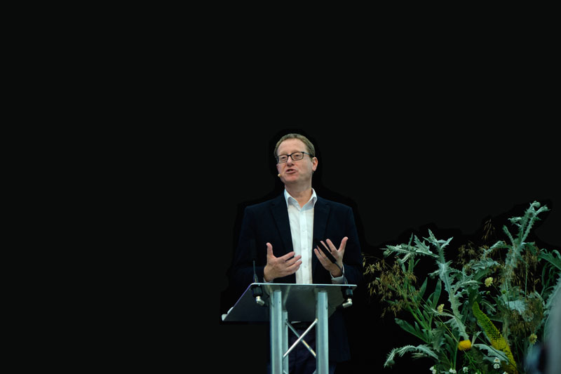 Jonathan Saul Freedland, British journalist, who writes a weekly column for The Guardian. He presents BBC Radio 4's contemporary history series, The Long View. Freedland also writes best-selling thrillers, mainly under the pseudonym Sam Bourne - photographed here on the podium at the Wimpole Hall History Festival