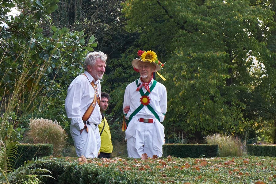 Morris dancers in conversation at Apple Day at the Botanic Gardens in Cambridge - closeup