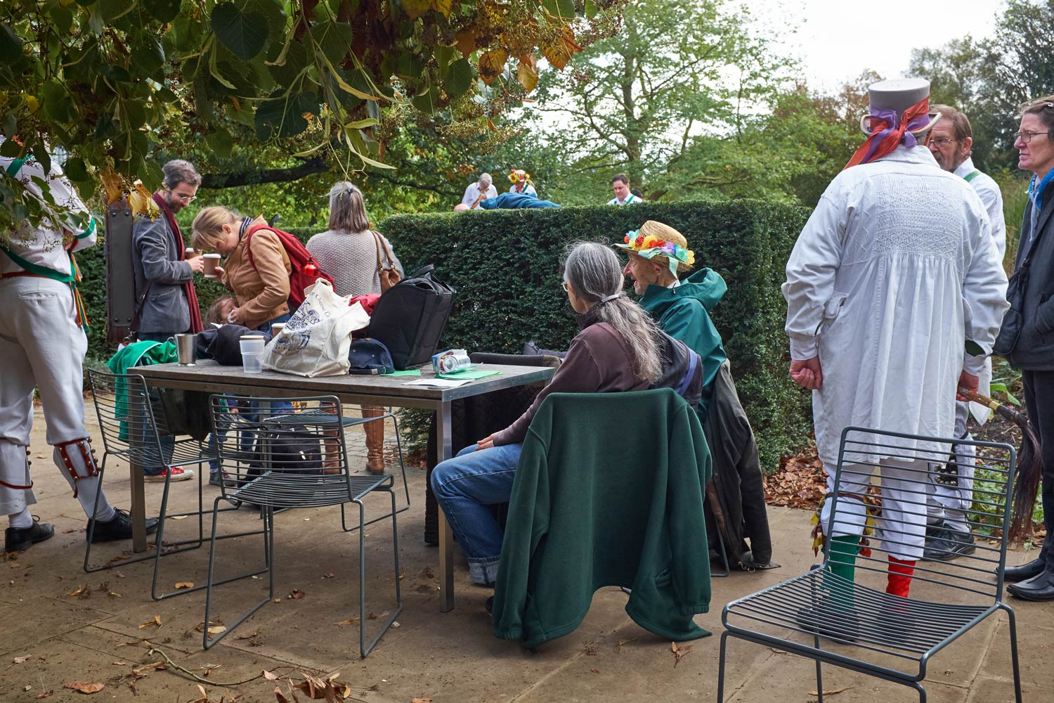 Morris dancers and others in conversation at Apple Day at the Botanic Gardens in Cambridge