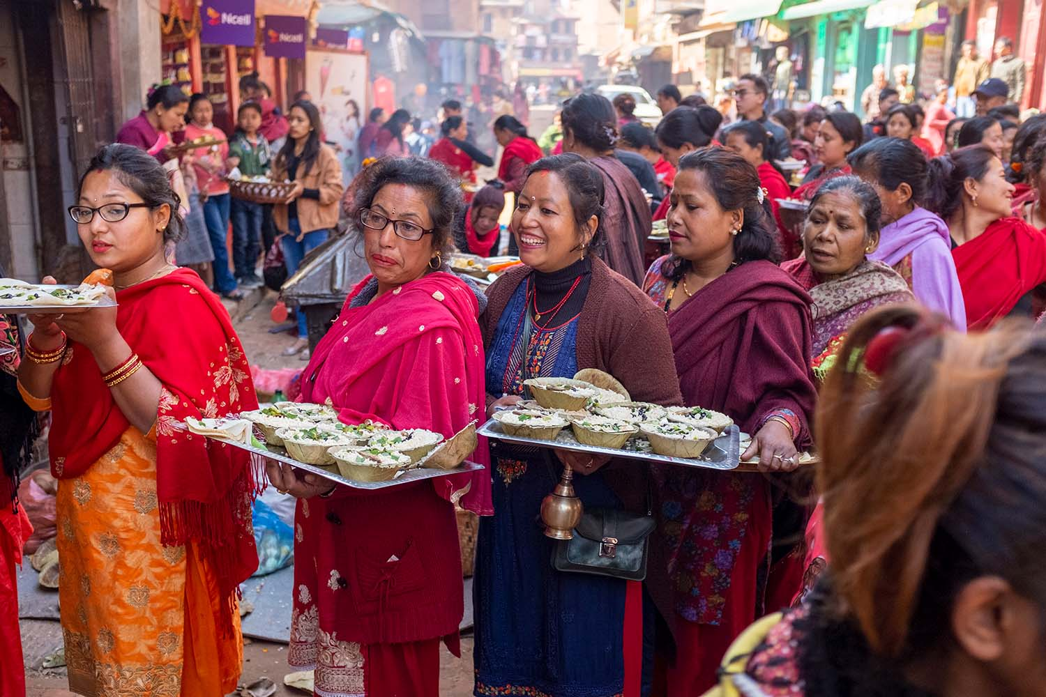 Nepali women with offerings during a festival
